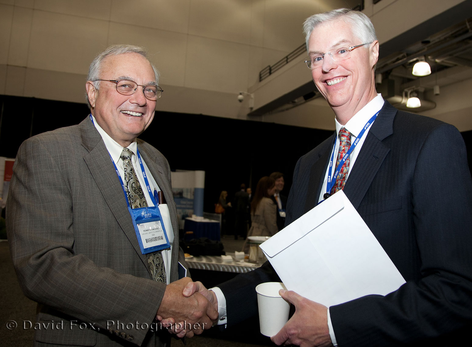 IFA Conference Attendees Shake Hands Networking
