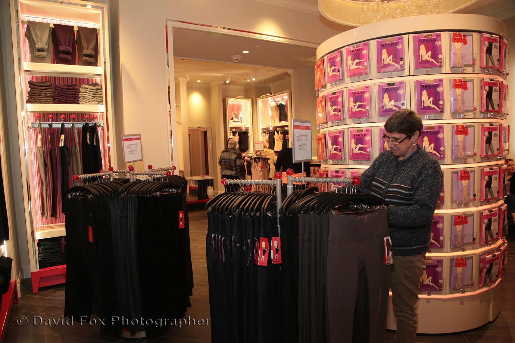 A Shopper checkes out Merchandise at Spanx Store Opening