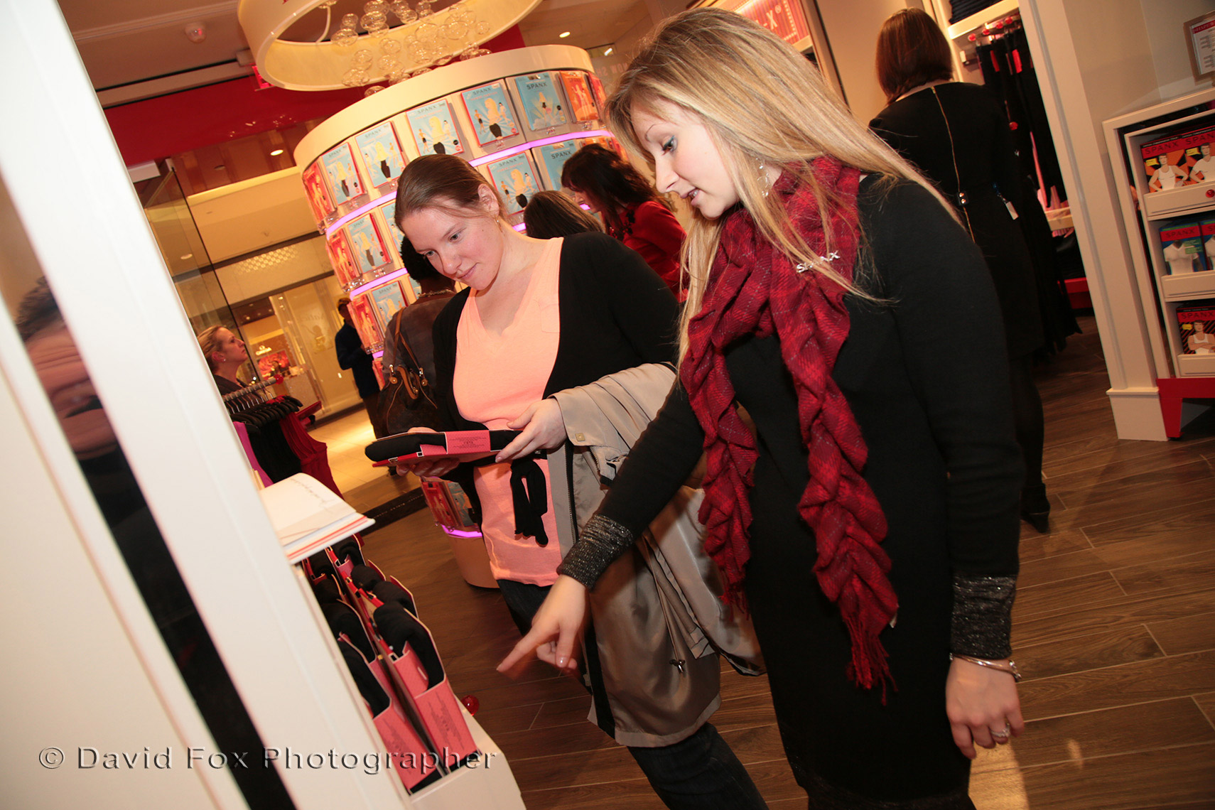 A Sales Associate Helps a Shopper at Spanx Store Opening
