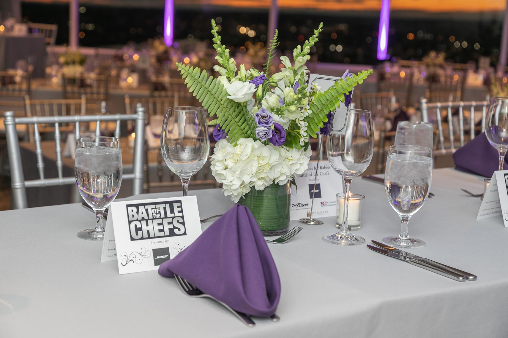 004-Table setting with event signs for the March of Dimes Black Ties for Babies Gala