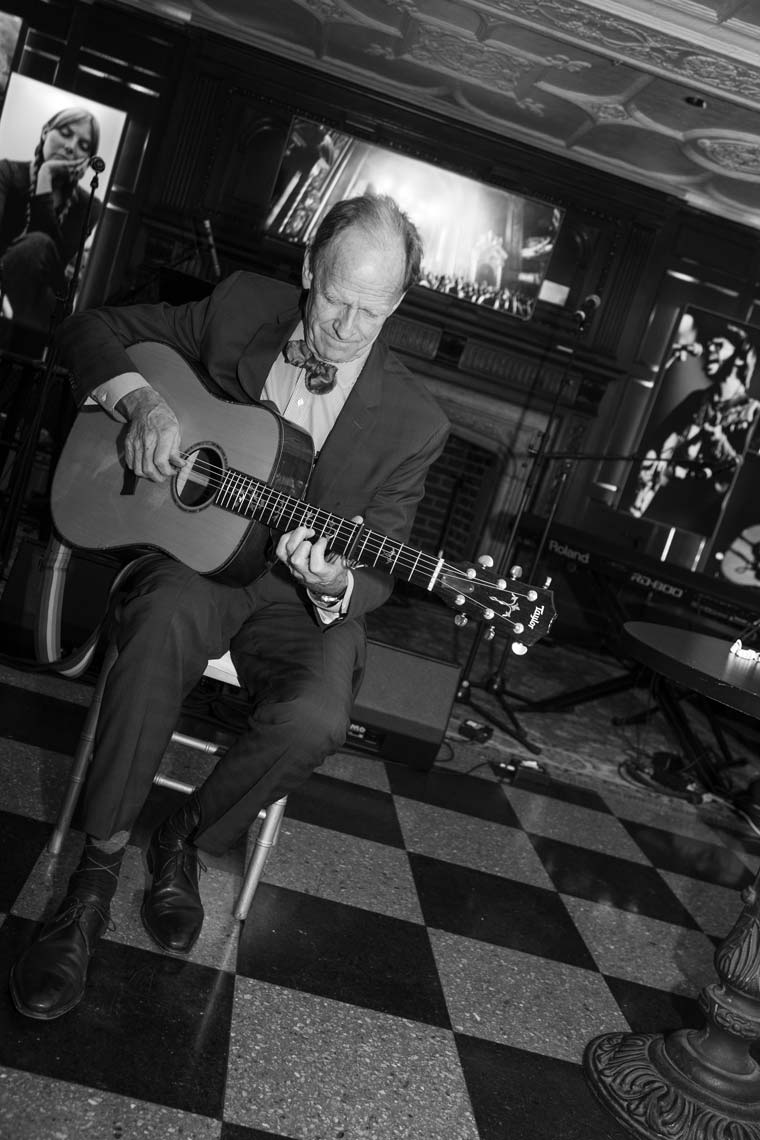Livingston Taylor warming up on his guitar before the show