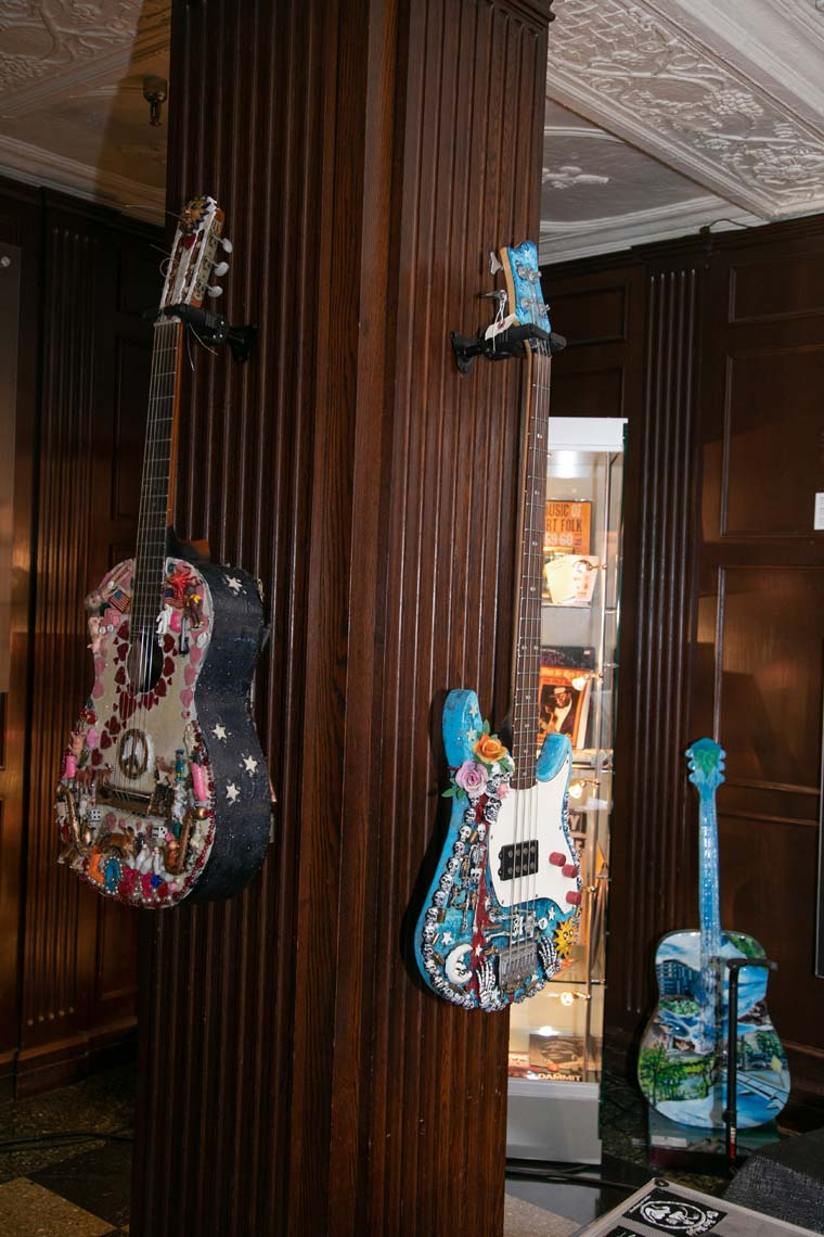 Wildly decorated guitars on display at the Folk/Americana/Roots Hall of Fame