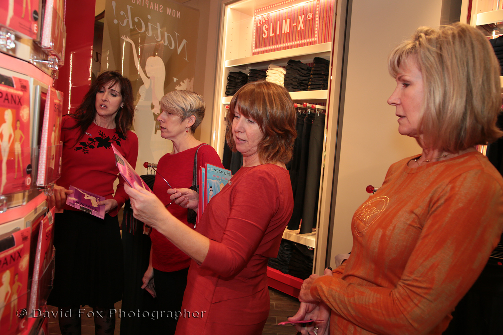 Customers looking at the Merchandise at Spanx Natick