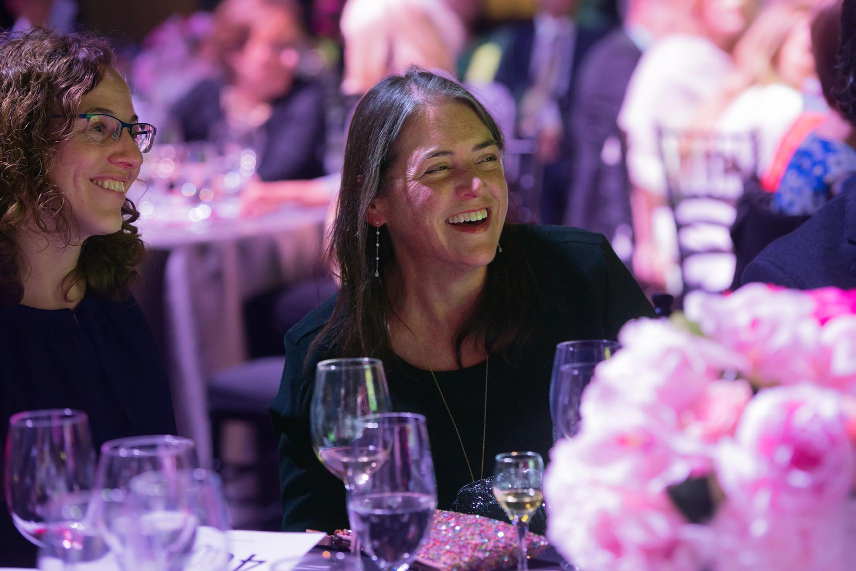 A guest laughs at the Safe and Sound gala for Rosies Place