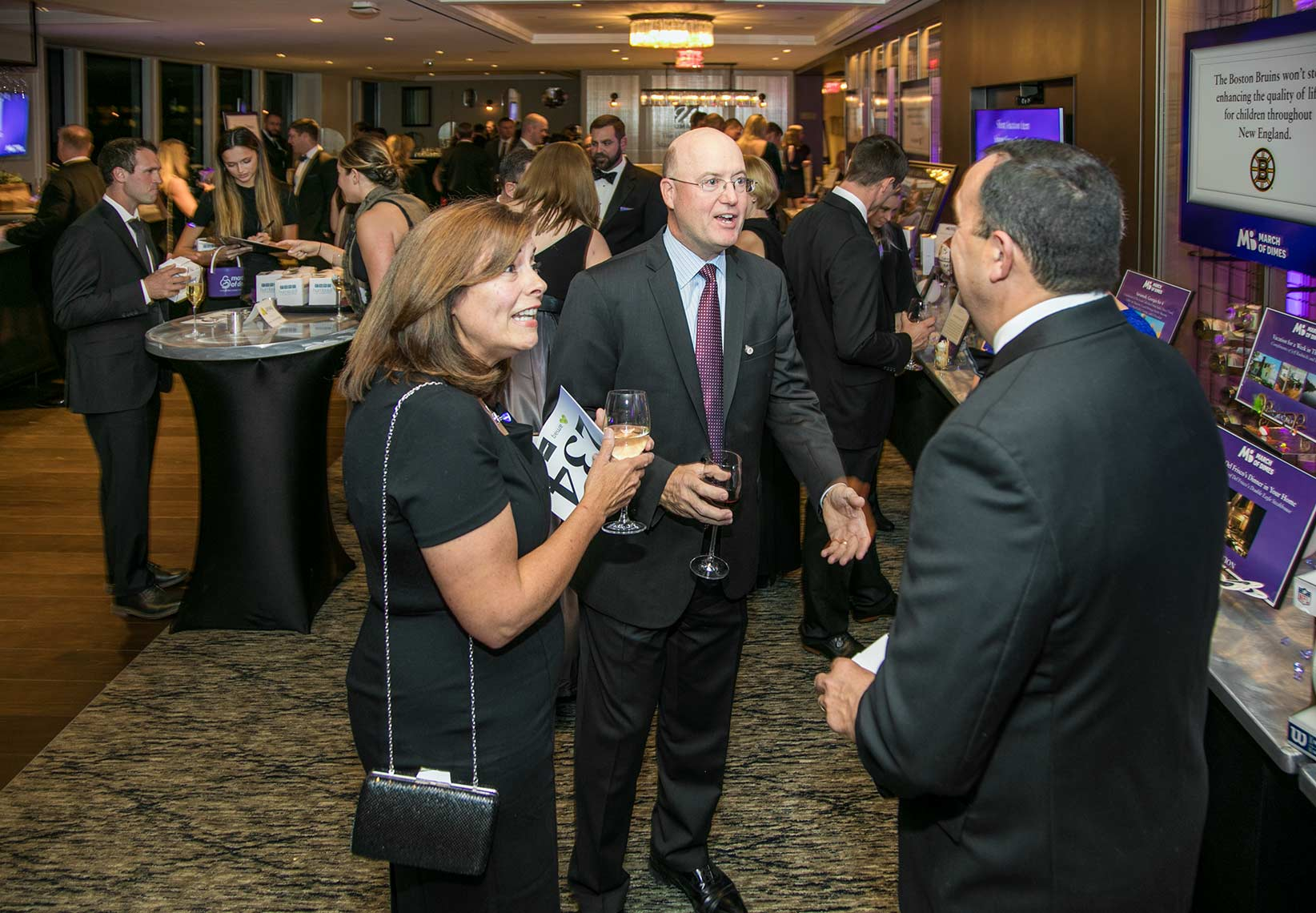 012-Attendees mingle during the social hour at the Black Ties for Babies fundraiser for the March of Dimes