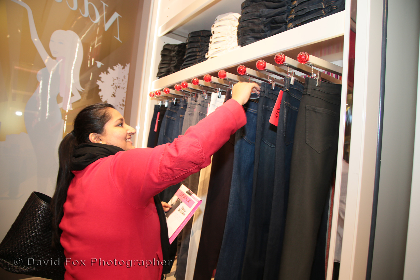 Happy Customer Looking Jeans at Spanx Natick Store Opening