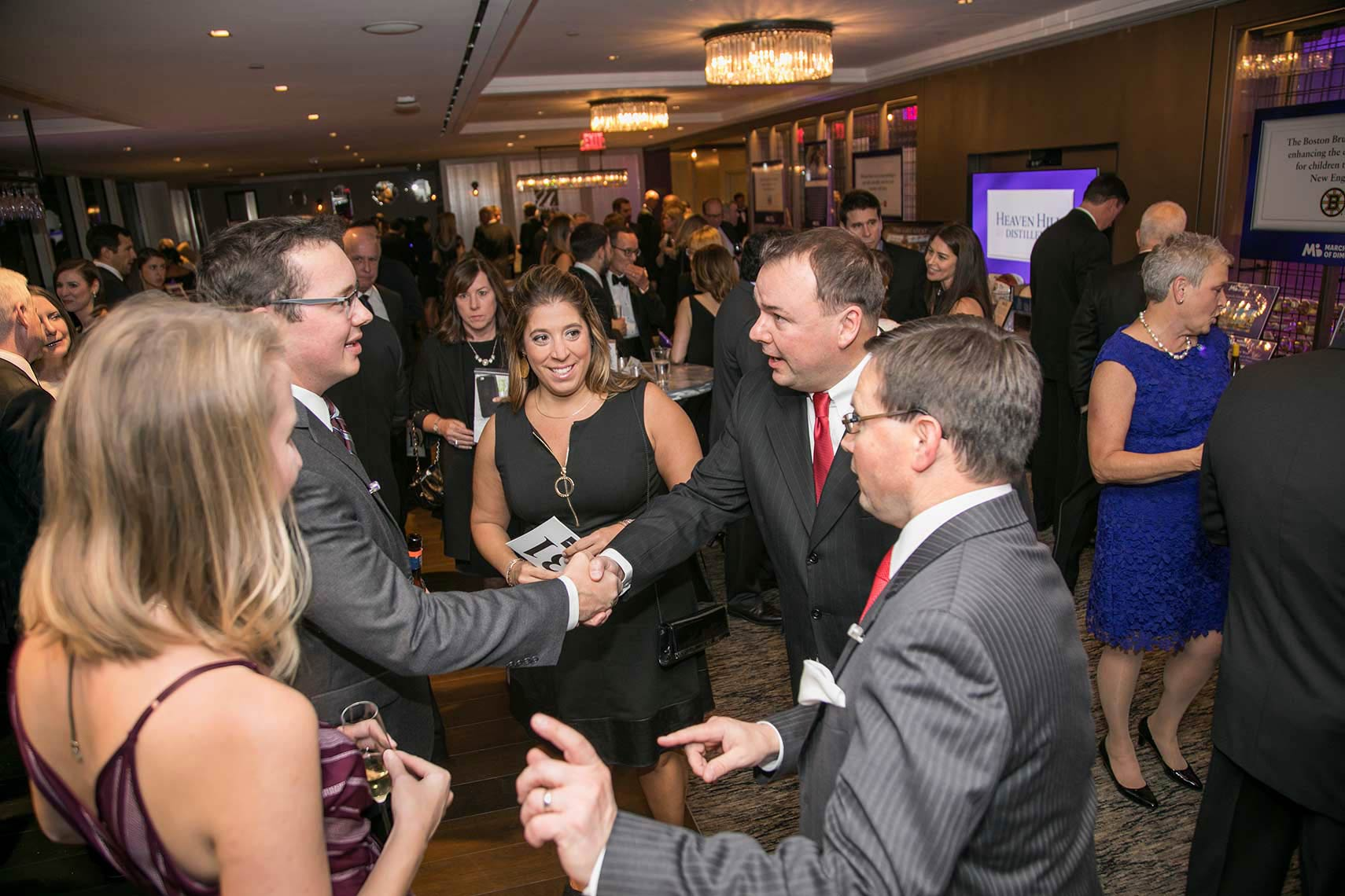 013-Guests-shake-hands-during-the-social-hour-at-the-Black-Ties-for-Babies-fundraiser-for-the-March-of-Dimes