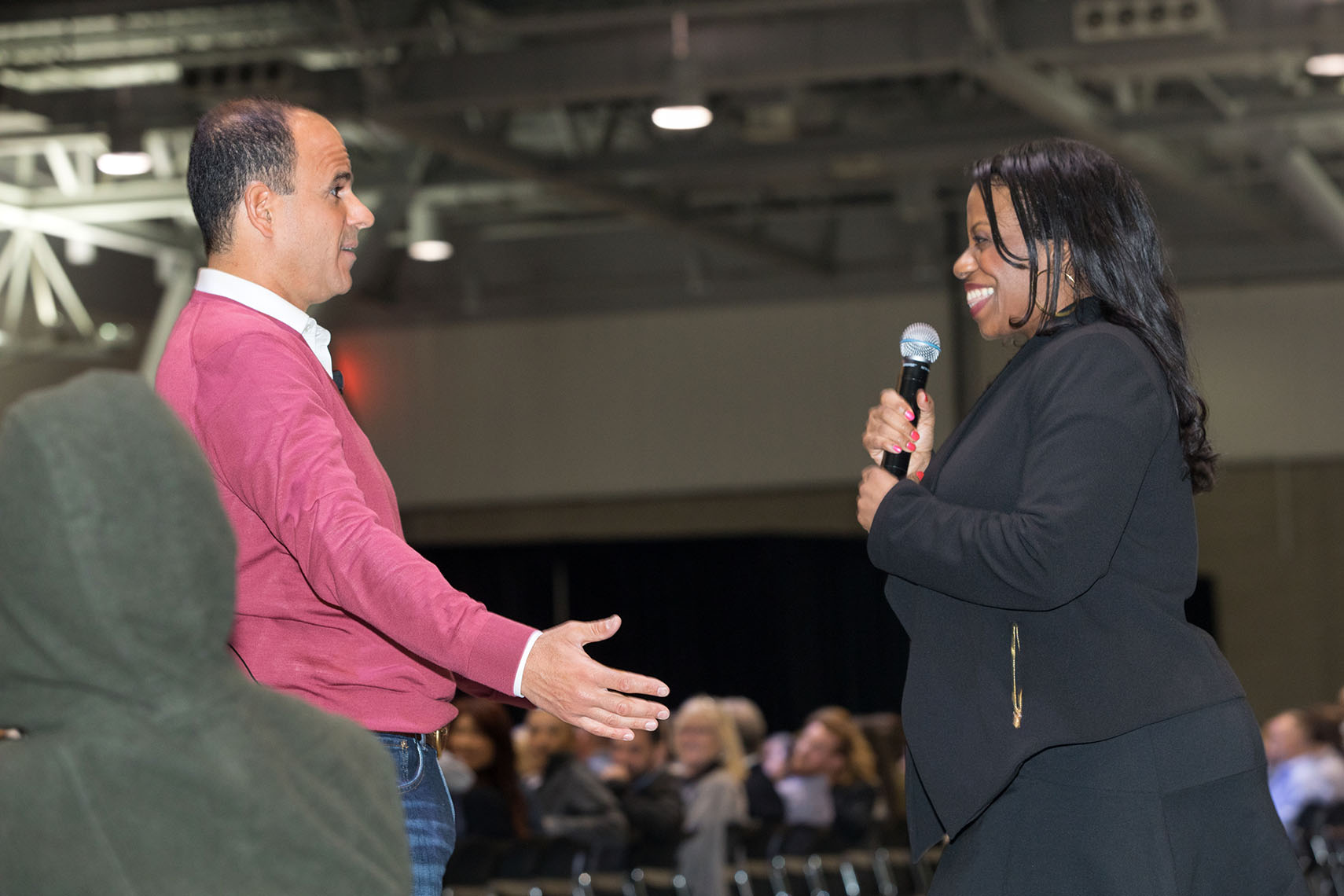 Marcus Lemonis Speaking with a Woman at the NAC Conference