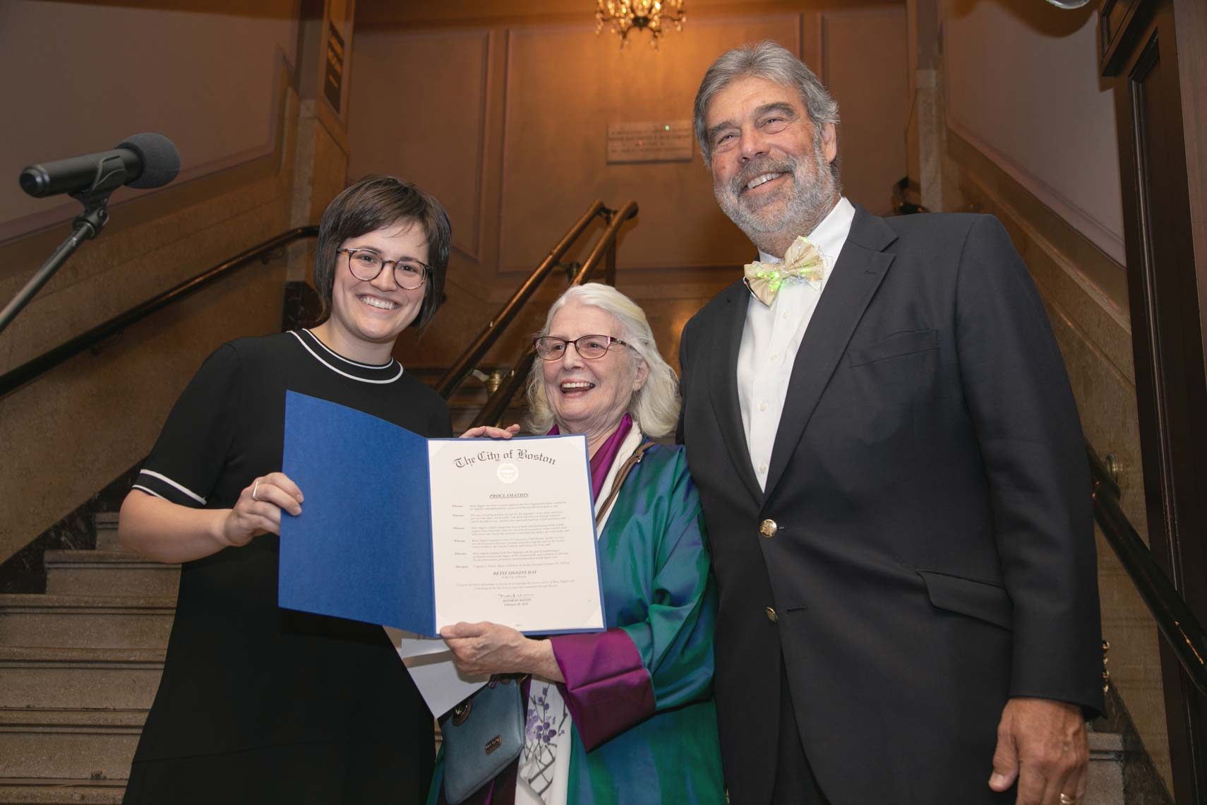 Betsy Siggins holds the proclamation of Betsy Siggins Day