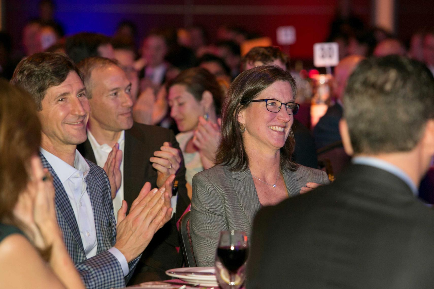 Happy Guests Applaud Winner at BuidFest Boston Auction