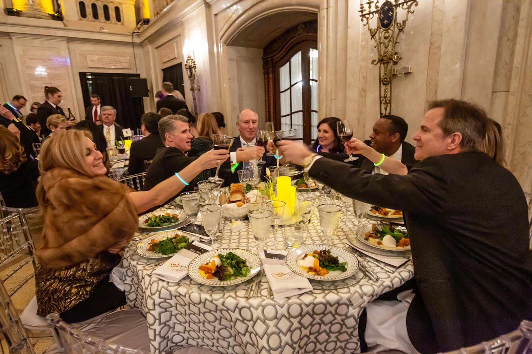 Gala dinner guests toast to a wonderful evening