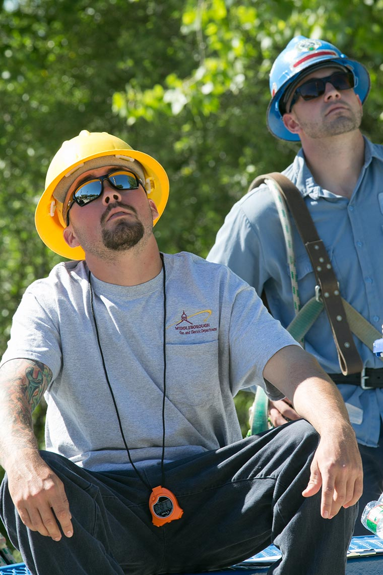 NEPPA Lineworkers Look on During Rodeo Day Competition Event