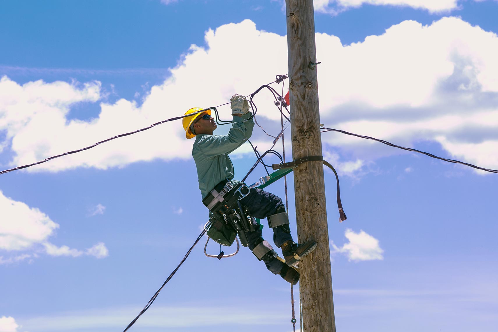 NEPPA Lineworker Works on Pole Wire During Rodeo Day Event