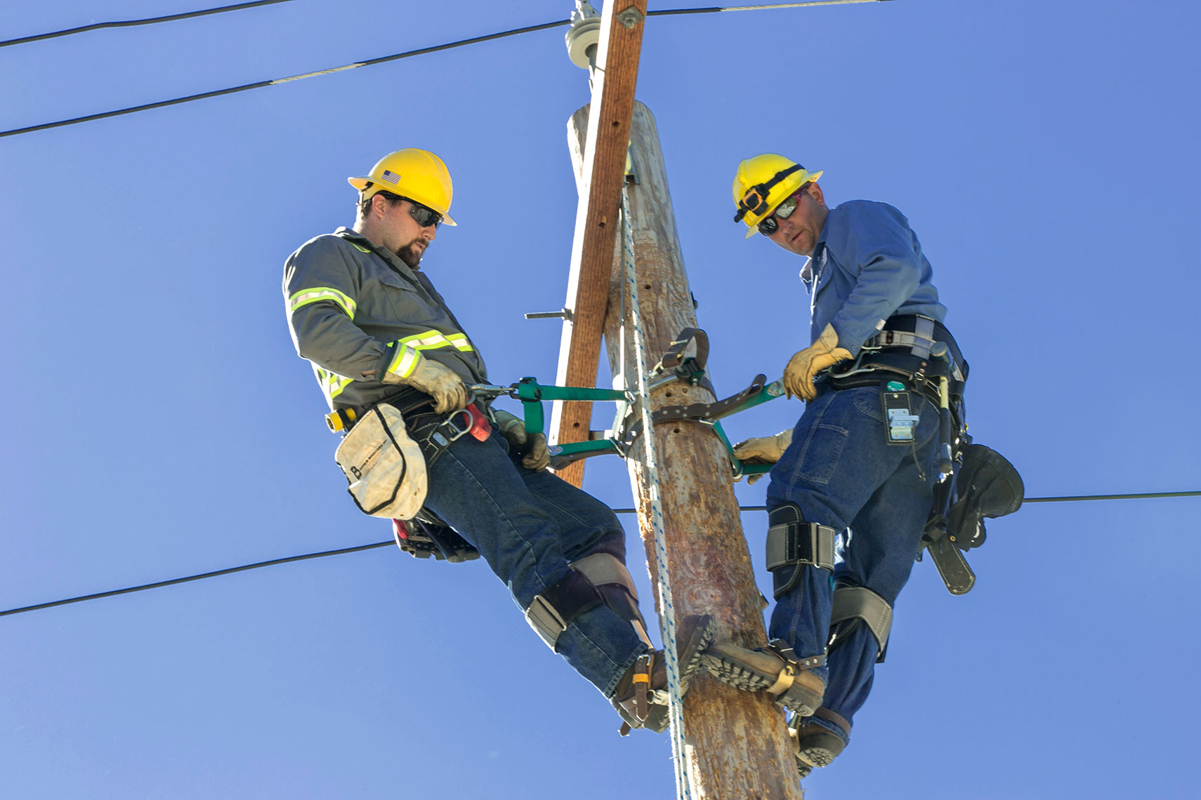 Lineworkers Reach top of Poles During Speed Climb Event