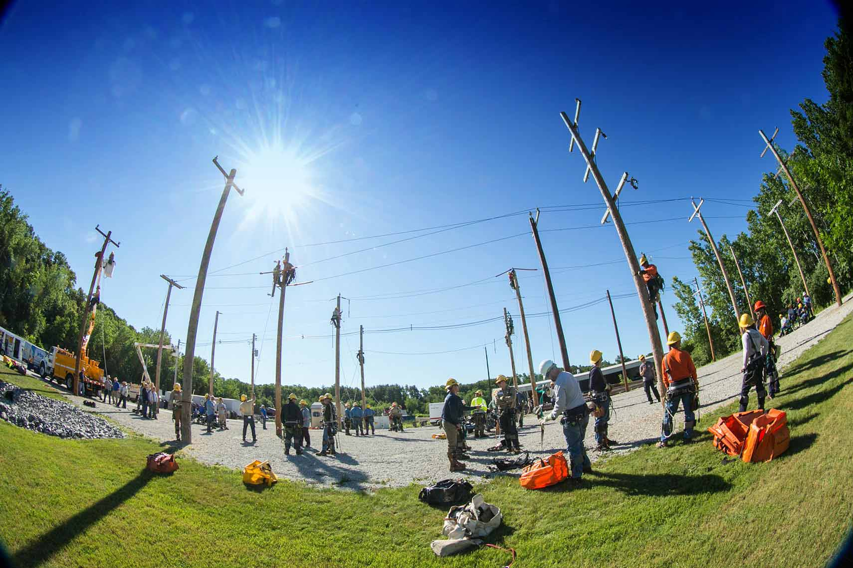 Wide Angle View of Lineworker and Poles at Rodeo Day Event