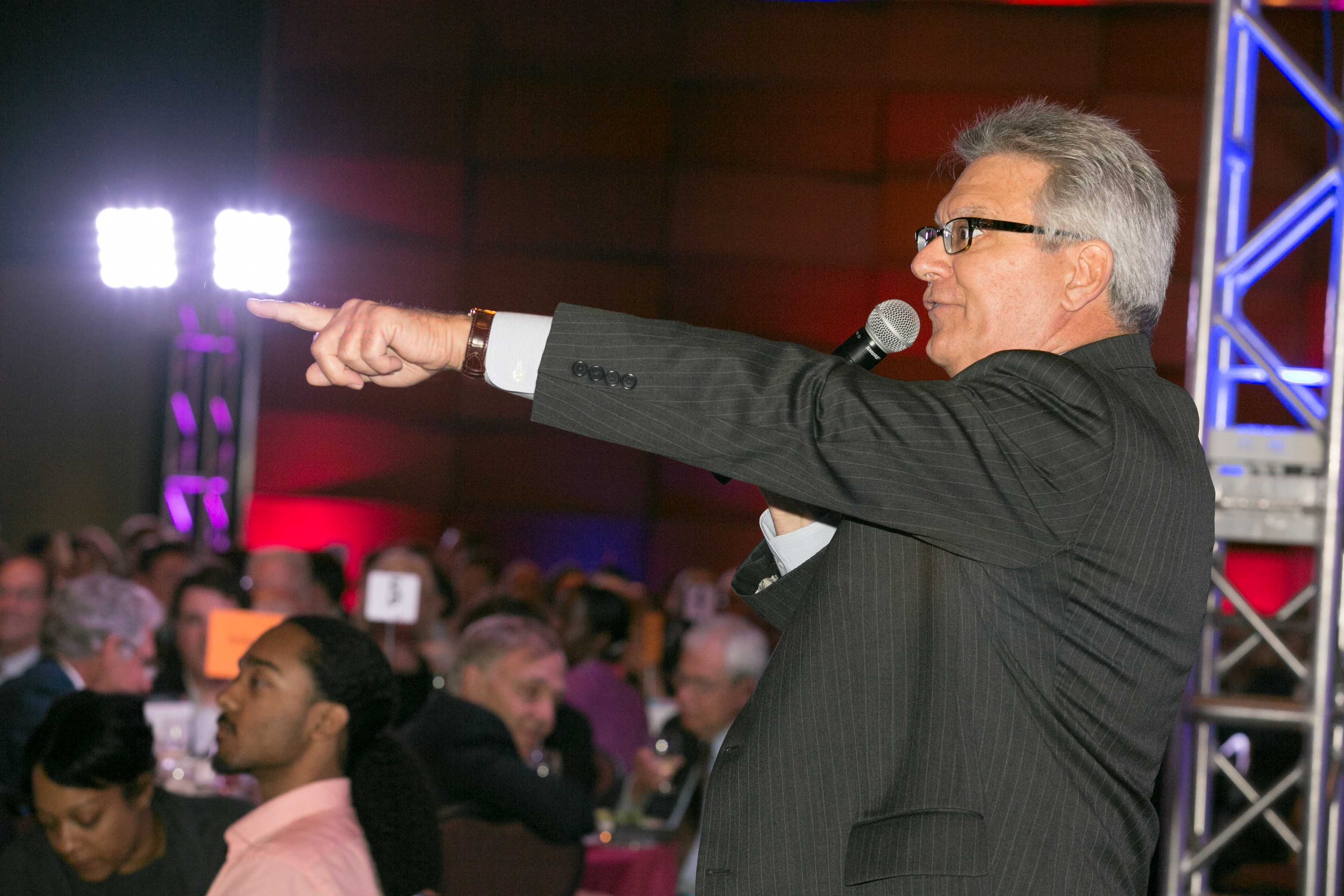 Auctioneer Points at Winner at Build Fest Boston Auction 2016