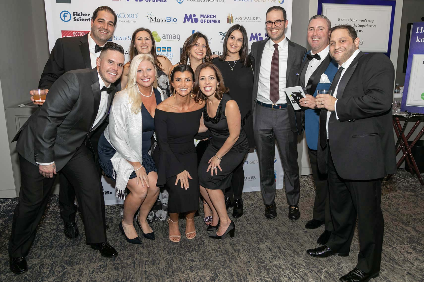 035-Group-photo-of-event-attendees-by-the-step-and-repeat-banner-at-the-March-of-Dimes-gala