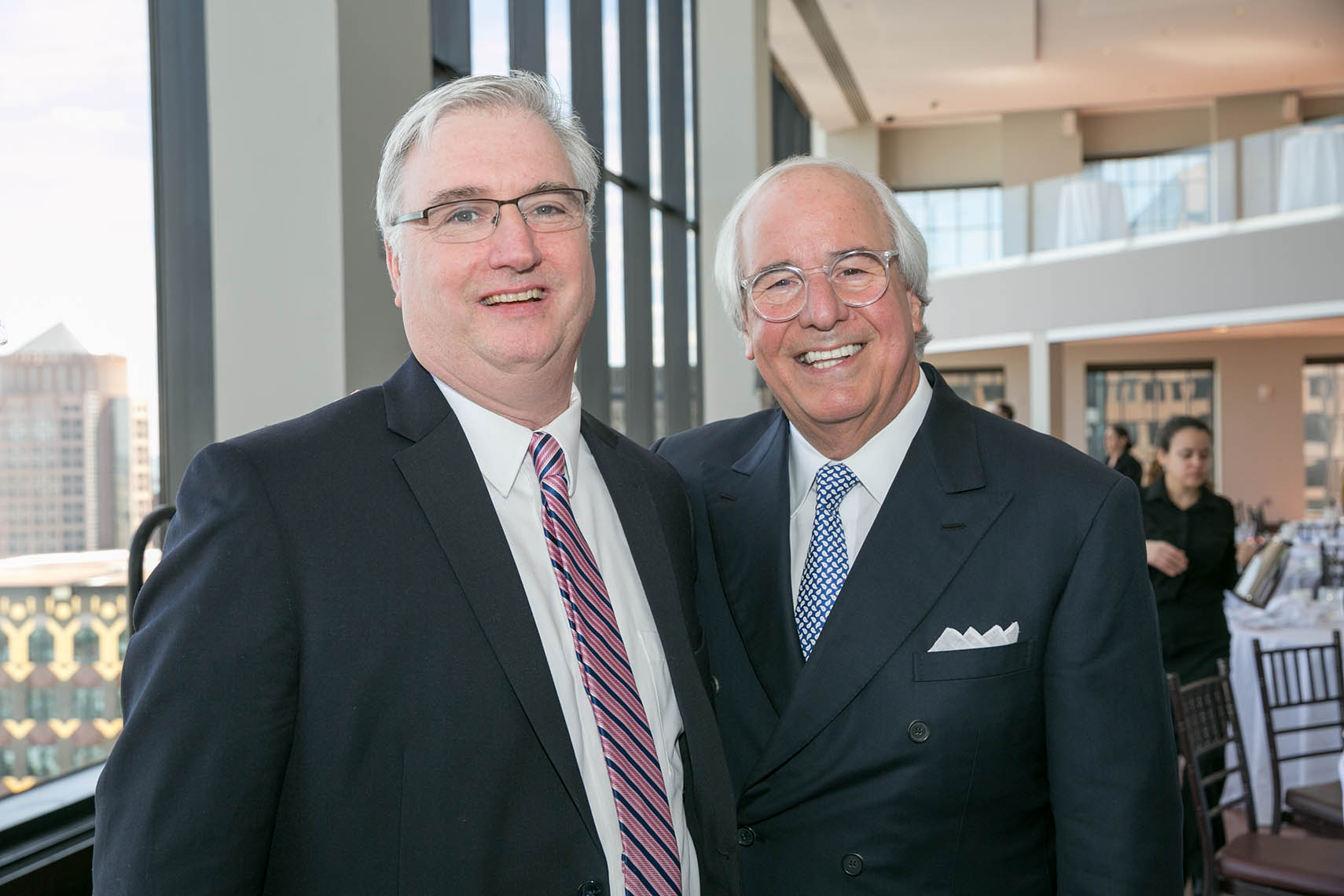 Frank Abagnale poses with a member of the Association of Legal Administrators Boston Chapter