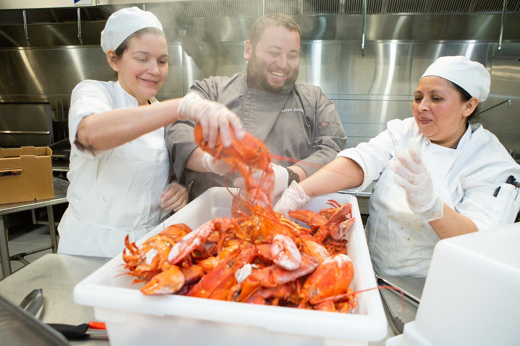 Levy food service workers prep hot lobsters for dinner