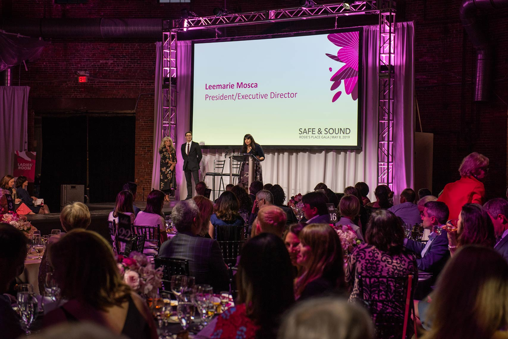 Leemarie Mosca speaking on stage at the Safe and Sound gala