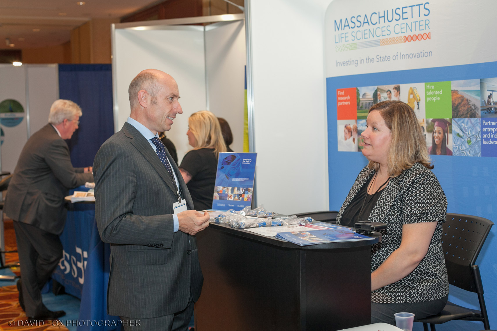 Conference Attendee Speaks with Vendor Representative