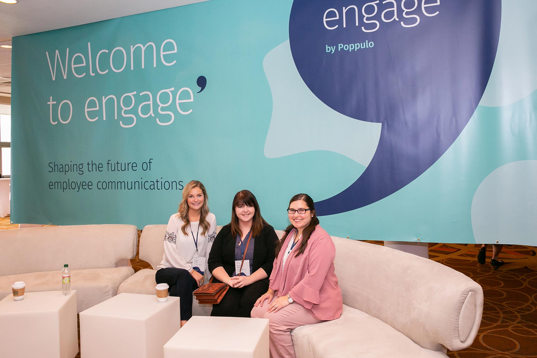 Three women sit together durring a break at Engage Boston