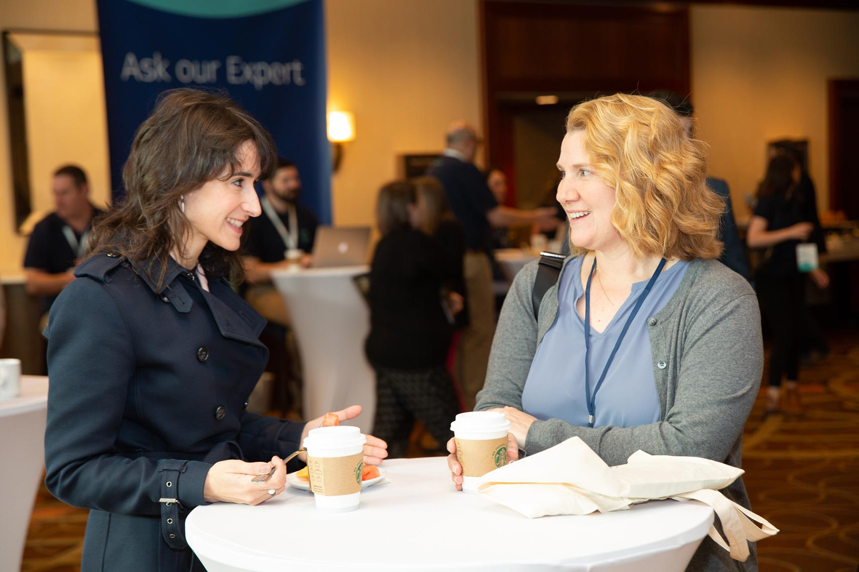Two women networking during a break at Engage Boston
