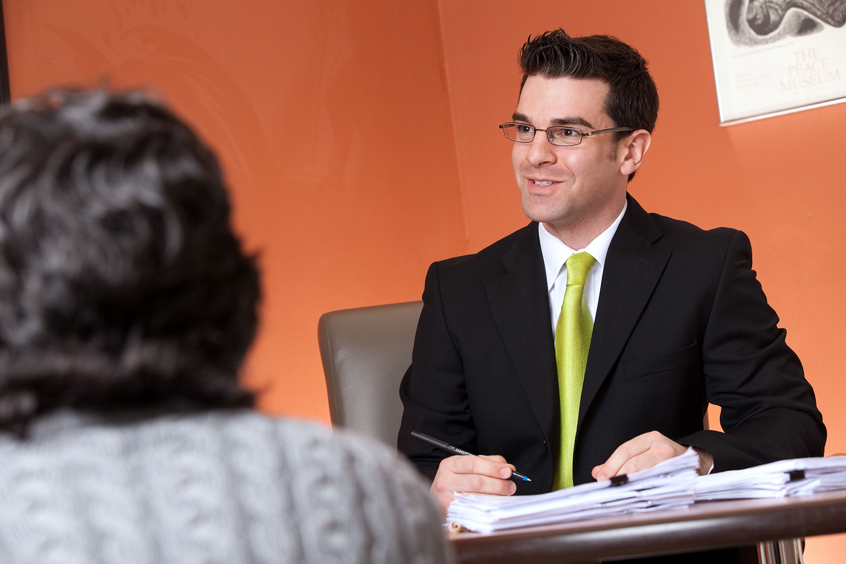 Attorney-Peter-Mello-Speaks-with-Client-in-Office-Meeting