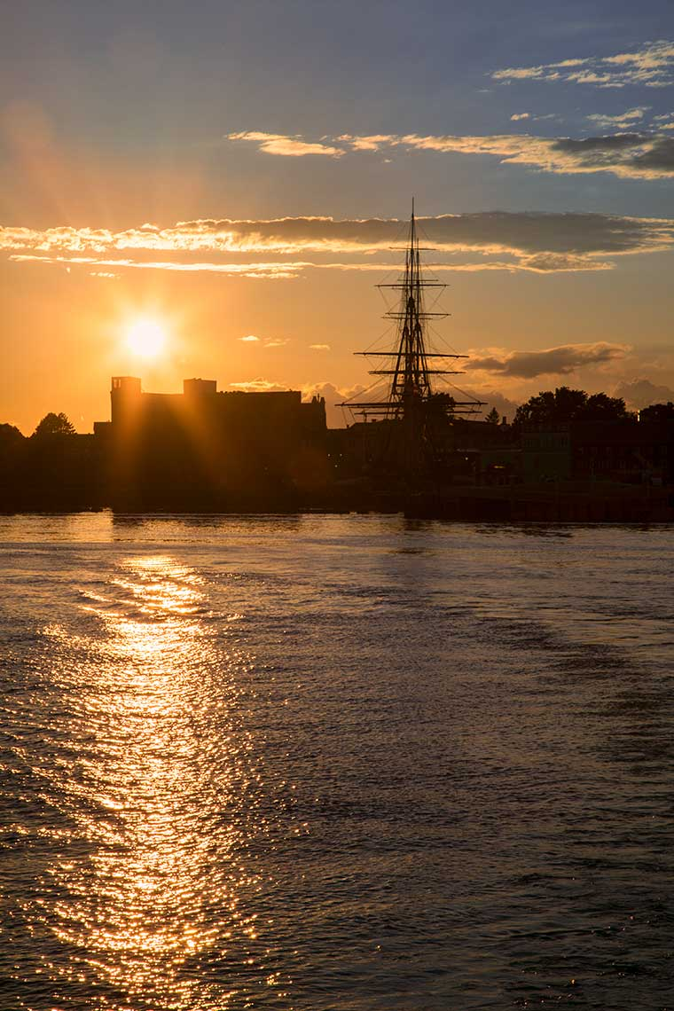 Sunset view of the USS Constitution from Boston Harbor