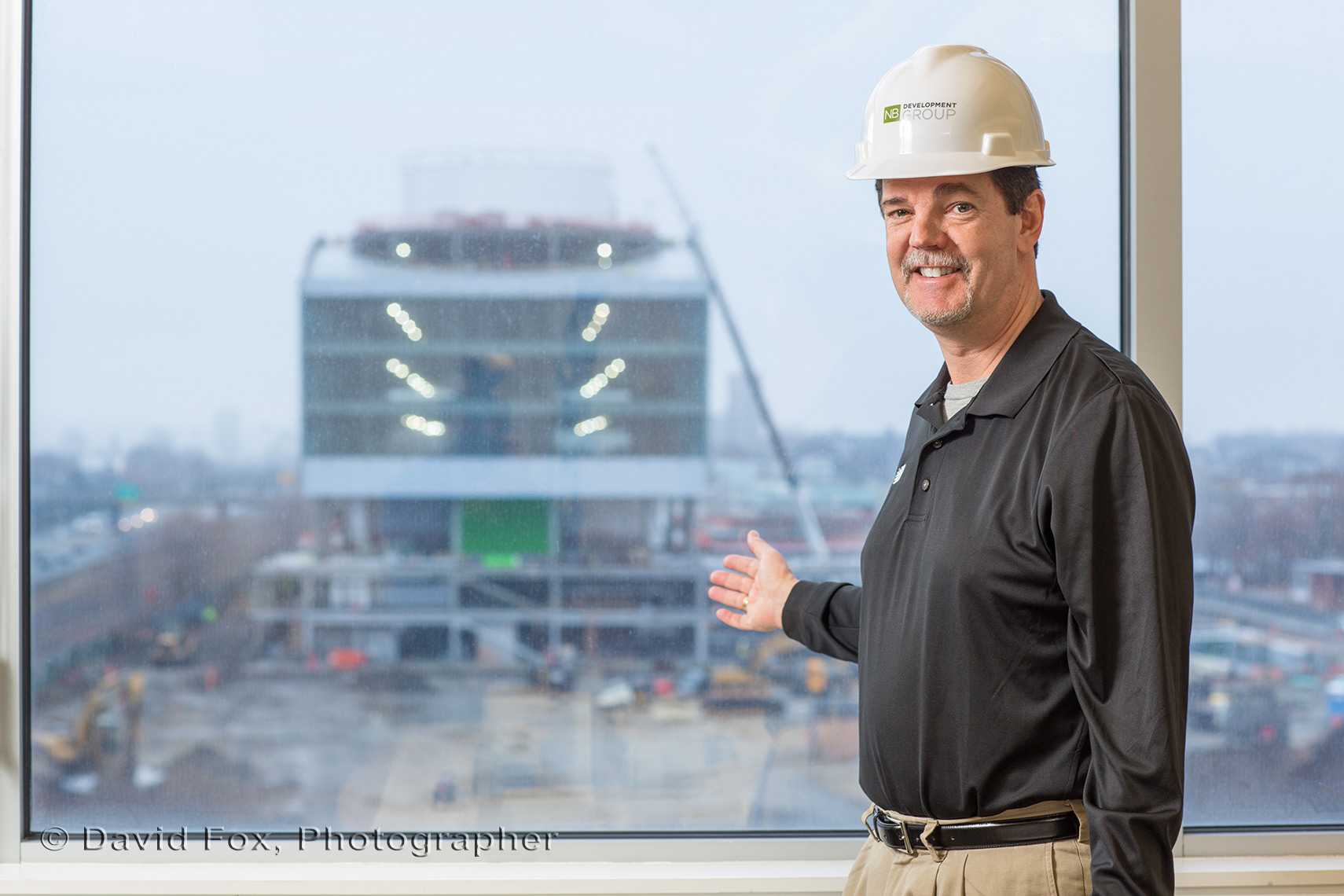 Peter Henderson Points to Construction for New Head Quarters