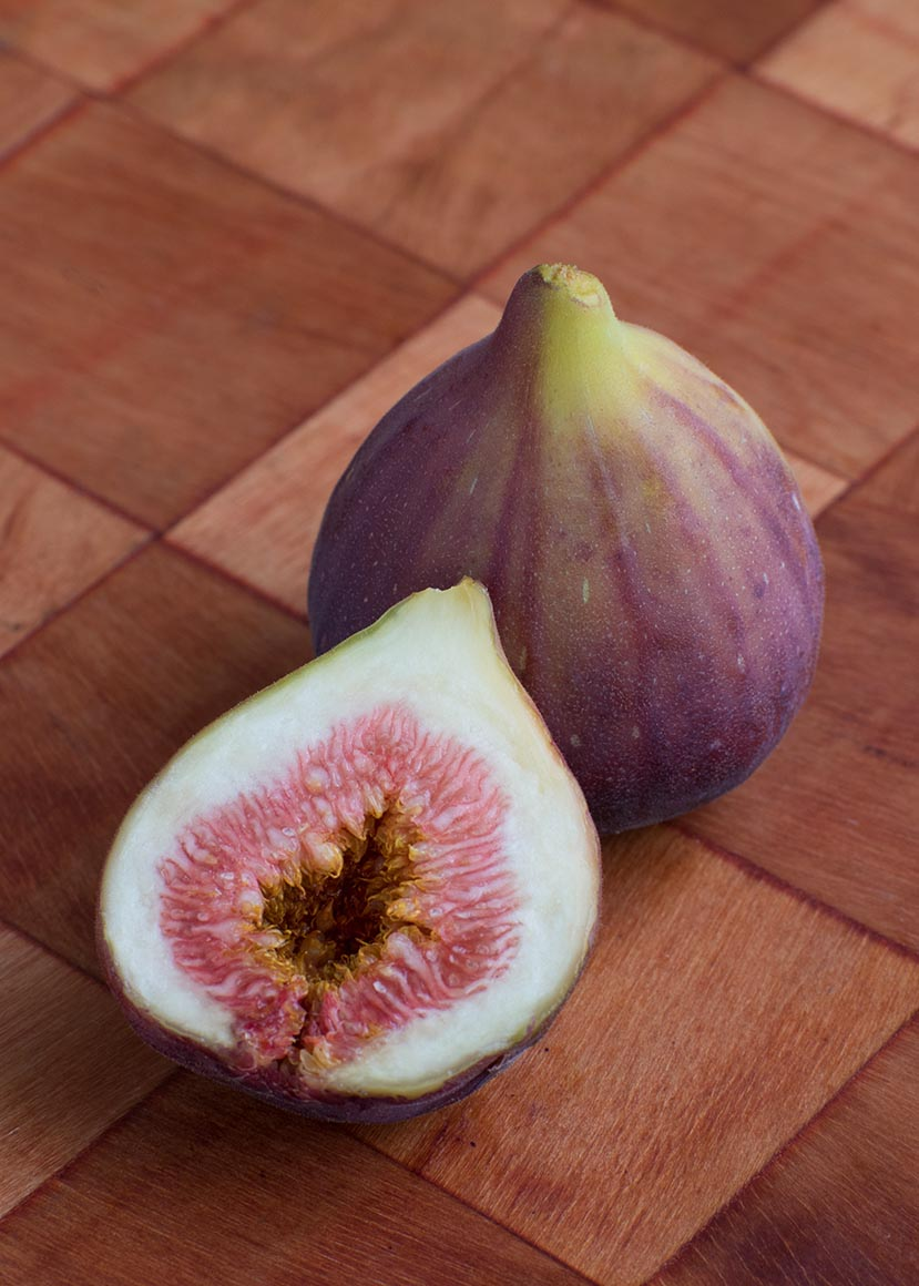Fresh figs on wooden cutting board