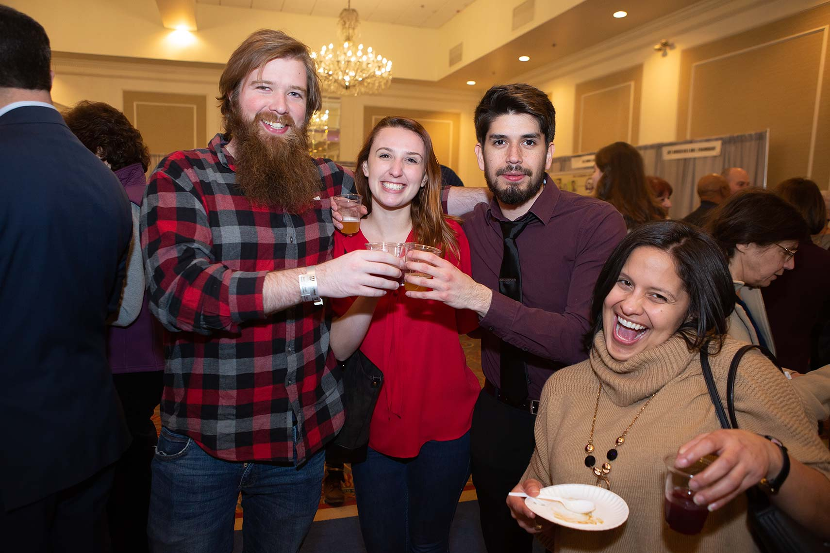 Friends and attendees toast each other at Taste of Metrowest