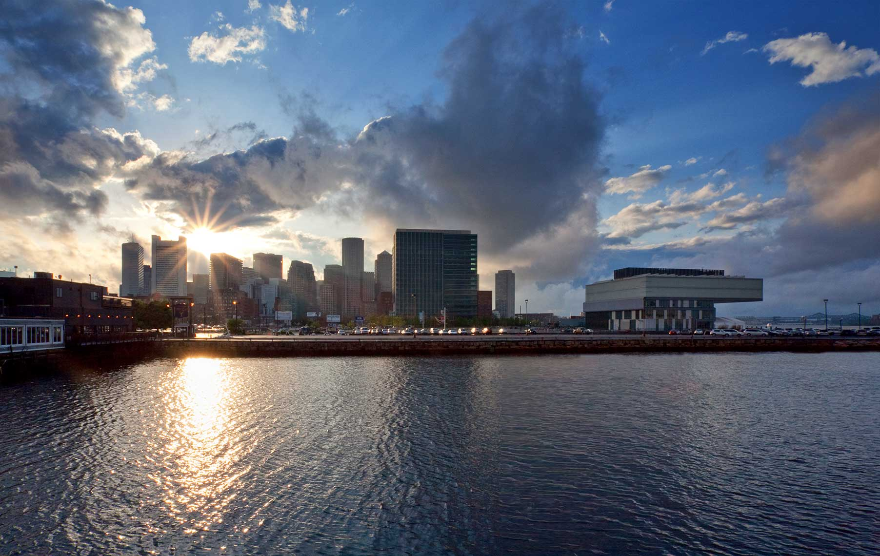 Sunburst behind Downtown Boston with the ICA from Commonwealth Pier