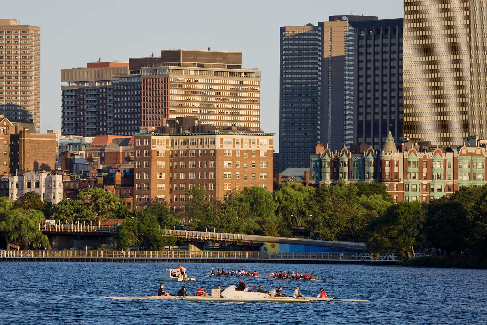 Scullers rowing on the Charles River with Barnes Mansion in the background