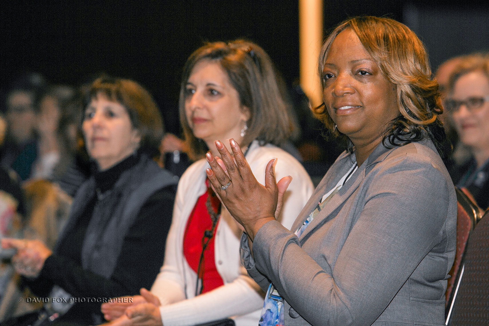 Audience Members Applaud Award Recipient at NSTA Conference