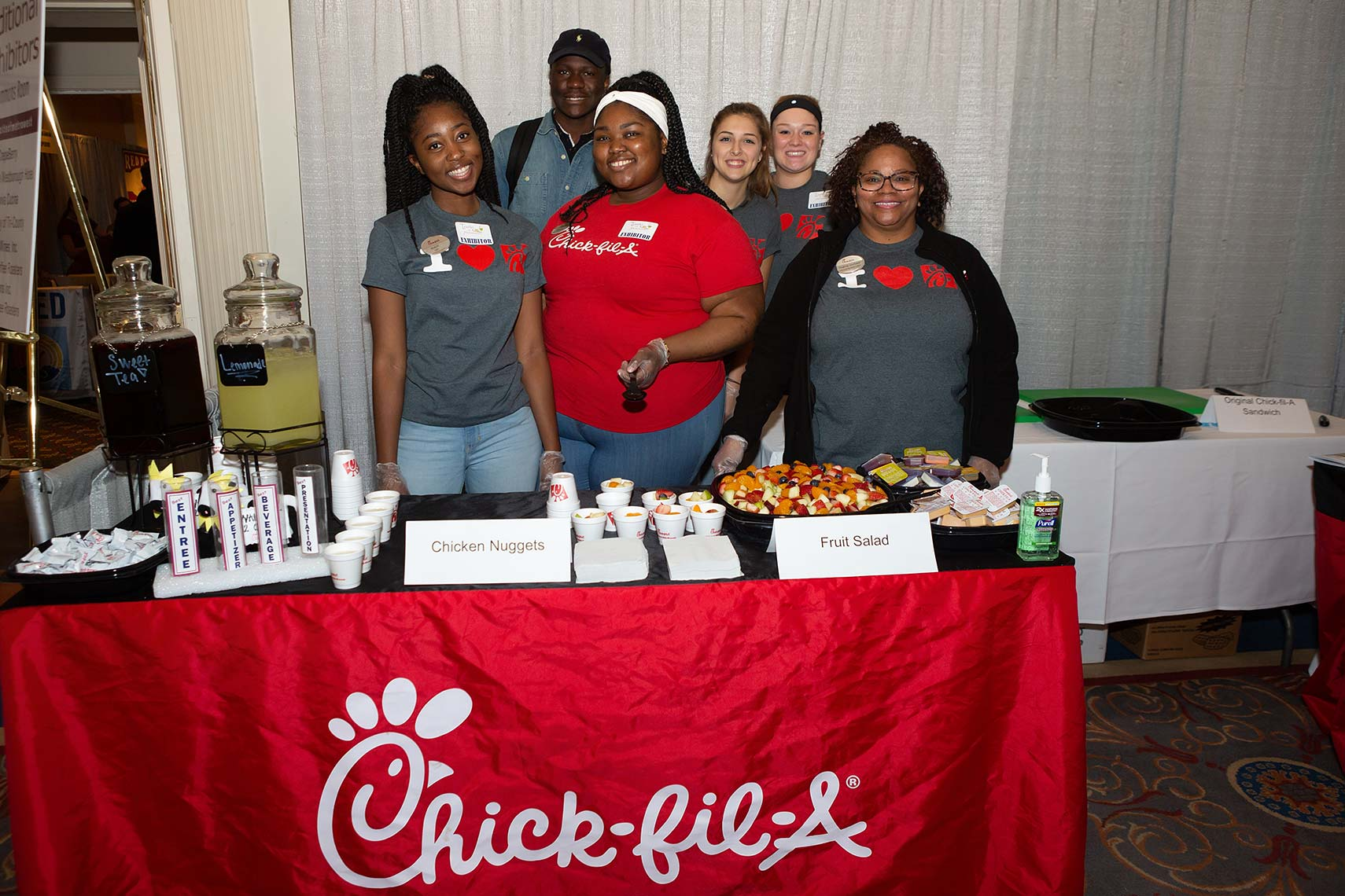 Chick-fil-A employees at their booth at the Taste of Metrowest