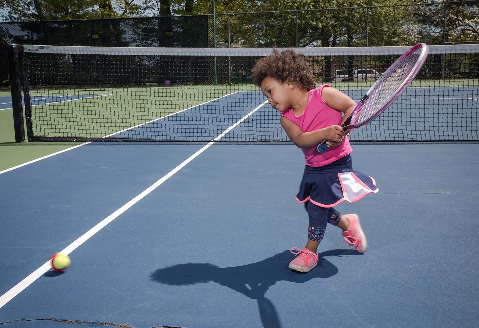 Young Girl Learning to Play Tennis with USTA New England