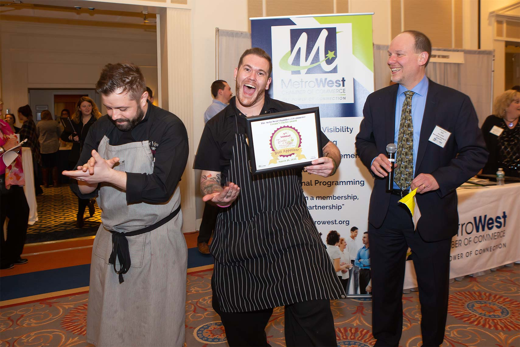 Winner of Best Appetizer at Taste of Metrowest holds award