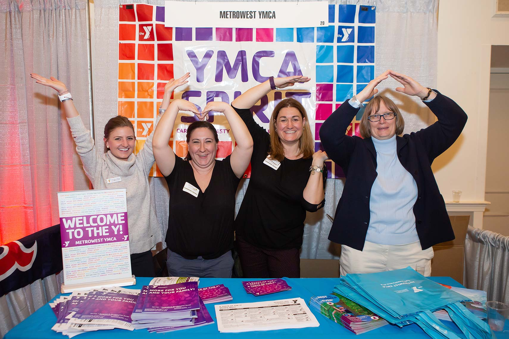 YMCA employees pose out the letters for this fun photo